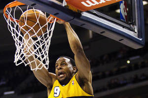 Photo - Denver Nuggets' Andre Iguodala (9) dunks off an alley-oop during the first quarter of an NBA basketball game against the Orlando Magic, Wednesday, Jan. 9, 2013, in Denver. (AP Photo/Barry Gutierrez)