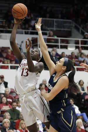 Photo - Stanford forward Chiney Ogwumike (13) shoots against UC Davis forward Alyson Doherty during the first half of an NCAA college basketball game in Stanford, Calif., Sunday, Nov. 17, 2013. (AP Photo/Jeff Chiu)