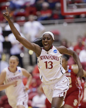 Photo - Stanford's Chiney Ogwumike (13) celebrates after scoring in the first half of a first-round game in the NCAA women's college basketball tournament against South Dakota in Ames, Iowa, Saturday, March 22, 2014. (AP Photo/Nati Harnik)