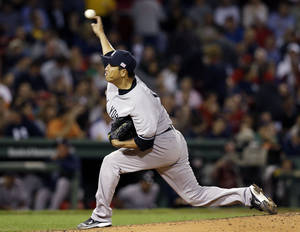 Photo -   New York Yankees starting pitcher Hiroki Kuroda, of Japan, delivers to the Boston Red Sox during the third inning of a baseball game at Fenway Park in Boston, Tuesday, Sept. 11, 2012. (AP Photo/Elise Amendola)