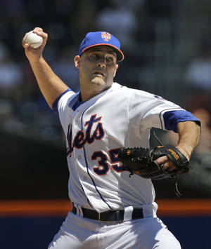Photo - New York Mets starting pitcher Dillon Gee throws during the second inning of an interleague baseball game against the Detroit Tigers at Citi Field, Sunday, Aug. 25, 2013, in New York. (AP Photo/Seth Wenig)