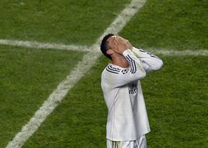 Photo - Real's Cristiano Ronaldo covers his face after winning the Champions League final soccer match between Atletico Madrid and Real Madrid in Lisbon, Portugal, Saturday, May 24, 2014. (AP Photo/Paulo Duarte)