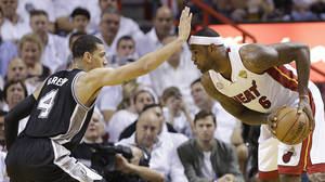 Photo - Miami Heat small forward LeBron James (6) and San Antonio Spurs shooting guard Danny Green (4) work during the first half of Game 1 of basketball's NBA Finals, Thursday, June 6, 2013 in Miami. (AP Photo/Lynne Sladky)