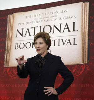 Photo - FILE - This Sept. 25, 2010 file photo shows former first lady Laura Bush speaking at the 10th annual National Book Festival, organized and sponsored by the Library of Congress, on the National Mall in Washington. After a decade on the National Mall, the National Book Festival is moving to a new location this year due to new rules and costs associated with holding a large event on the promenade between the Capitol and Lincoln Memorial. The Library of Congress announced Wednesday that the popular literary event will move this year to the Washington Convention Center and will add a movie screening and cinema programs in the evening. This year's festival is scheduled for Aug. 30. (AP Photo/Carolyn Kaster, File)