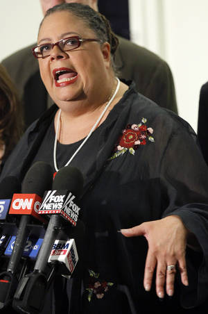 "photo -   Karen Lewis, president of the Chicago teachers union responds to a question after meeting of the union's House of Delegates Friday, Sept. 14, 2012, in Chicago. Lewis told the delegates that a ""framework"" was in place to end the teachers strike. (AP Photo/Charles Rex Arbogast)"