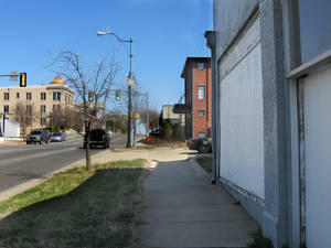 Photo - Much of MidTown has been redeveloped into upscale housing, shops and restaurants, as shown in the foreground along NW 10. But the area still has several long boarded up buildings like the one shown at 320 NW 10.