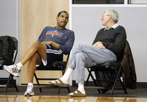 Photo - OKLAHOMA CITY THUNDER NBA BASKETBALL: Oklahoma City's Maurice Cheeks talks with Hank Egan during the Thunder's practice in Oklahoma City, Sunday, Dec. 11, 2011. Photo by Sarah Phipps, The Oklahoman