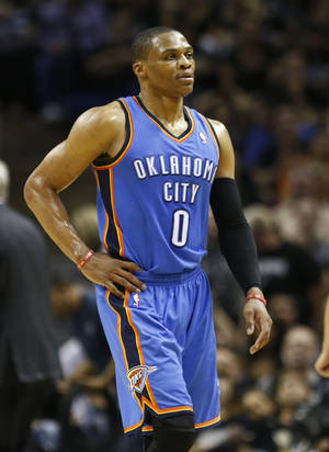 Photo - Oklahoma City's Russell Westbrook (0) walks back toward the bench during Game 2 of the Western Conference Finals in the NBA playoffs between the Oklahoma City Thunder and the San Antonio Spurs at the AT&T Center in San Antonio, Wednesday, May 21, 2014. Photo by Sarah Phipps, The Oklahoman
