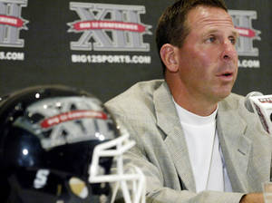 Photo - Nebraska coach Bo Pelini speaks to reporters during Big 12 Media Days on Monday. AP PHOTO
