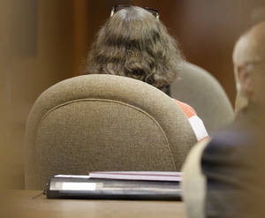 Photo - Wdow Rebecca Bryan sat silently staring straight ahead throughout her 35-minute sentencing Tuesday afternoon at the Canadian County courthouse. <strong>Steve Gooch - The Oklahoman</strong>