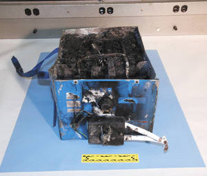 Photo - The burned auxiliary power unit battery is shown from a Japan Airlines Boeing 787 that caught fire Jan. 7, at Boston's Logan International Airport.  AP Photo