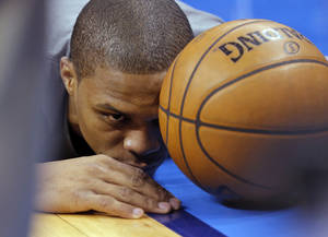 Photo - Oklahoma City's Russell Westbrook (0) gets focused in before the start of Game 2 in the first round of the NBA playoffs between the Oklahoma City Thunder and the Houston Rockets at Chesapeake Energy Arena in Oklahoma City, Wednesday, April 24, 2013. Photo by Chris Landsberger, The Oklahoman