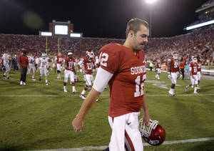 photo - Oklahoma's Landry Jones (12) walks off the field after a college football game between the University of Oklahoma Sooners (OU) and the Kansas State University Wildcats (KSU) at Gaylord Family-Oklahoma Memorial Stadium, Saturday, September 22, 2012. Oklahoma lost 24-19. Photo by Bryan Terry, The Oklahoman