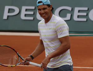 Photo - Defending champion Spain's Rafael Nadal smiles during a training session for the French Open tennis tournament, at the Roland Garros stadium in Paris, Friday, May 23, 2014. The French Open tennis championship will start Sunday. (AP Photo/Bertrand Combaldieu)