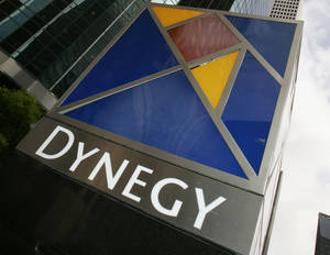Photo - FILE - This March 8, 2006 file photo shows the Dynegy Inc. headquarters in Houston. Dynegy on Friday, Aug. 22, 2014 announced plans to spend more than $6 billion to buy several coal and gas power generation plants from Duke Energy and Energy Capital Partners. (AP Photo/David J. Phillip, File)