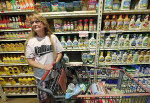 Photo -  Karen Dover shops with her son, Justin Fennel, at Pruett's Food in the town of Valliant on Monday. Photo by Jim Beckel, The Oklahoman  <strong>Jim Beckel -   </strong>