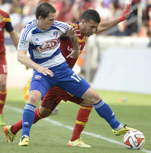 Photo - Real Salt Lake midfielder Javier Morales, right, goes for the ball along with FC Dallas defender Zach Loyd (17) during an MLS soccer game on Saturday, May 24, 2014, in Sandy, Utah. (AP Photo/The Salt Lake Tribune, Rick Egan) LOCAL TV OUT; MAGAZINES OUT; DESERET NEWS OUT