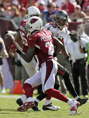 Photo - Arizona Cardinals cornerback Patrick Peterson (21) intercepts a pass intended for Tampa Bay Buccaneers wide receiver Vincent Jackson (83) during the fourth quarter of an NFL football game on Sunday, Sept. 29, 2013, in Tampa, Fla. (AP Photo/Chris O'Meara)
