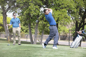 Photo - UCO students Clay Madden and Justin McCormick play at Kickingbird Golf Course in Edmond. Photo By David McDaniel/The Oklahoman <strong>David McDaniel - The Oklahoman</strong>