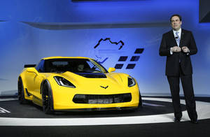 Photo - Mark Reuss, incoming General Motors head of global product development, introduces the 2015 Chevrolet Corvette Z06 at media previews at the North American International Auto Show in Detroit, Monday, Jan. 13, 2014. (AP Photo/Paul Sancya)