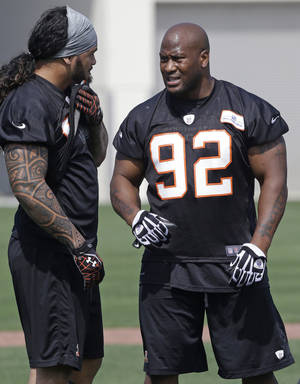 Photo - Cincinnati Bengals linebackers James Harrison (92) and Rey Maualuga talk during NFL football practice, Wednesday, May 29, 2013, in Cincinnati. Cincinnati hosts the Indianapolis Colts this Thursday, Aug. 29, 2013,  in their final preseason game. (AP Photo/Al Behrman)
