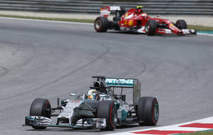 Photo - Mercedes driver Lewis Hamilton of Britain steers his car during the second training session at the race track  in Spielberg,  Austria,  Friday, June 20, 2014. The Austrian Formula One Grand Prix will be held on Sunday. (AP Photo/Darko Bandic)