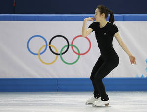 Photo - Yuna Kim of South Korea skates during a practice session at the Iceberg Skating Palace during the 2014 Winter Olympics, Sunday, Feb. 16, 2014, in Sochi, Russia. (AP Photo/Darron Cummings)