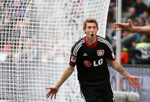 Photo - Leverkusen's Stefan Kiessling celebrates after scoring during the German first division Bundesliga soccer match between Bayer Leverkusen and Hertha BSC Berlin in Leverkusen, Germany,  Sunday April 13,2014. (AP Photo/Rolf Vennenbernd/dpa)