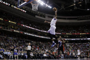 Photo - Philadelphia 76ers' Thaddeus Young goes up for a dunk in the second half of an NBA basketball game against the Toronto Raptors, Friday, Jan. 18, 2013, in Philadelphia. Philadelphia won 108-101 in overtime. (AP Photo/Matt Slocum)