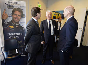 Photo - Red Bull technical director Adrian Newey, right, and Red Bull team principal Christian Horner, left, talk with Charlie Whiting, center, International Automobile Federation (FIA) Race Director, during an FIA Appeal Court hearing, Paris, Monday, April 14, 2014. The dispute resolution tribunal for motorsport is hearing Red Bull's case against the disqualification of Daniel Ricciardo from the Australian Grand Prix. (AP Photo/Eric Vargiolu, Pool)