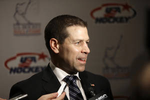 Photo - Doug Weight addresses the media before his induction into the United States Hockey Hall of Fame in Detroit, Monday, Dec. 2, 2013. Weight is an assistant coach for the New York Islanders. (AP Photo/Carlos Osorio)