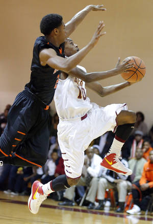 photo - Douglass' Travon Threatt defends as Centennial's Malcolm Mitchell shoots a lay up during the boy's high school basketball between Centennial High School and Douglass High School in Centennial High School in Oklahoma City, Friday,Dec. 14, 2012. Photo by Sarah Phipps, The Oklahoman