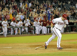 Photo - Arizona Diamondbacks Aaron Hill runs out his RBI walk off base hit against the San Diego Padres during the 10th inning of a baseball game, Tuesday, Aug. 27, 2013, in Phoenix. The Diamondbacks won 10-9.(AP Photo/Matt York)