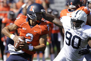 Photo -   Penn State defensive end Sean Stanley (90) runs down Illinois quarterback Nathan Scheelhaase (2)during the first half of an NCAA college football game Saturday, Sept. 29, 2012, in Champaign, Ill. Penn State defeated Illinois 35-7. (AP Photo/Seth Perlman)