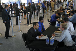 Photo -   In this Wednesday, Oct. 24, 2012, photo, job applicants are interviewed by Florida Marlins staff at Marlins Park in Miami. Weekly applications for U.S. unemployment aid fell last week to a seasonally adjusted 369,000, a level consistent with modest hiring. The Labor Department said Thursday, Oct. 25, 2012, that unemployment benefit applications dropped by 23,000, from a revised 392,000 the previous week. (AP Photo/Alan Diaz)