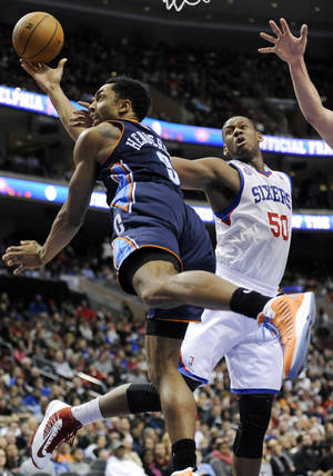 Photo - Philadelphia 76ers' Lavoy Allen (50) fouls Charlotte Bobcats' Gerald Henderson (9) during the first half of an NBA basketball game, Saturday, Feb. 9, 2013, in Philadelphia. (AP Photo/Michael Perez)