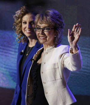 photo -   Former Rep. Gabrielle Giffords, right, walks with Democratic National Committee Chairwoman Rep. Debbie Wasserman Schultz, from Florida, to recite the Pledge of Allegiance the Democratic National Convention in Charlotte, N.C., on Thursday, Sept. 6, 2012. (AP Photo/Lynne Sladky)