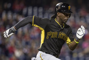 Photo - Pittsburgh Pirates' Andrew McCutchen runs to first base on a ground-out during the fourth inning of an exhibition baseball game against the Philadelphia Phillies, Friday, March 28, 2014, in Philadelphia. (AP Photo/Chris Szagola)