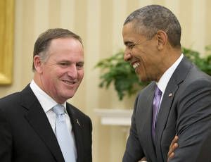 Photo - President Barack Obama meets with New Zealand's Prime Minister John Key, Friday, June 20, 2014, in the Oval Office of the White House in Washington. (AP Photo/Pablo Martinez Monsivais)