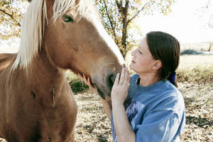 photo - Cheri White Owl interacts with one of her horses at Horse Feathers Equine Rescue facility in Guthrie in this file photo from 2009. The equine rescue group is among the beneficiaries of an upcoming mud run.  Photo by Paul Hellstern, The Oklahoman Archives