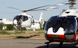 Photo - A U.S. Customs and Border Protection helicopter lands next to a medical helicopter Thursday in Oklahoma City.  Law enforcement chopper pilots and others gathered in Oklahoma City on Thursday for an aviation safety seminar. <strong>PAUL B. SOUTHERLAND - The Oklahoman</strong>