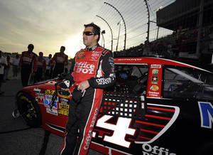 Photo -   Tony Stewart waits by his car before the NASCAR Sprint Cup Series auto race at Atlanta Motor Speedway, Sunday, Sept. 2, 2012, in Hampton, Ga. (AP Photo/Rainier Ehrhardt)