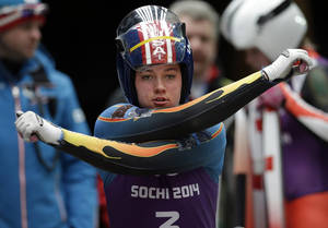 Photo - Kate Hansen of the United States warms up prior to starting her run during a training session for the women's singles luge at the 2014 Winter Olympics, Thursday, Feb. 6, 2014, in Krasnaya Polyana, Russia. (AP Photo/Michael Sohn)