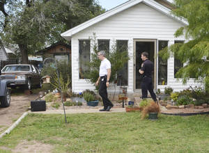 photo - Norman police officers search a house Wednesday afternoon. Police searched the house while investigating a shooting that happened near the residence Tuesday night. Photo by Andrew Knittle, The Oklahoman