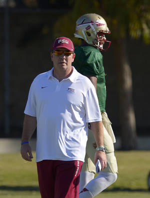 Photo - Florida State head coach Jimbo Fisher, left, looks on along with quarterback Jameis Winston during practice for their BCS Championship game against Auburn, Thursday, Jan. 2, 2014, in Costa Mesa, Calif. (AP Photo/Mark J. Terrill)