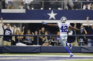 Photo - Dallas Cowboys safety Barry Church (42) returns a fumble by New York Giants running back David Wilson 27-yards for a touchdown during the second half of an NFL football game, Sunday, Sept. 8, 2013, in Arlington, Texas. (AP Photo/LM Otero)