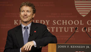 Photo - Sen. Rand Paul, R-Ky. smiles as he listens to a question during his public address at the John F. Kennedy Jr. Forum Institute of Politics at the Harvard Kennedy School, Friday April 25, 2014, in Cambridge, Mass. Fighting to move beyond his father's shadow, Paul is crafting new alliances with the Republican Party establishment during a Northeast tour that began Friday in Boston.  The 51-year-old Kentucky Republican, son of libertarian hero and former Texas Rep. Ron Paul, headlined an afternoon luncheon hosted by top lieutenants of former presidential nominee Mitt Romney _ a private meeting that comes as Paul weighs a 2016 presidential bid of his own.  (AP Photo/Stephan Savoia)