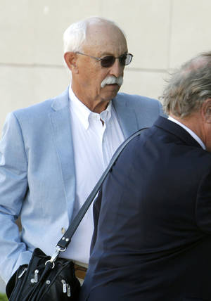 photo - Richard Hancock, a defendant in the Teddy Mitchell case, arrives with his attorney John Coyle at the Oklahoma City Federal Courthouse in Oklahoma City, OK, Friday, March 15, 2013,  By Paul Hellstern, The Oklahoman