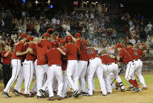 Photo - The Arizona Diamondbacks celebrate Miguel Montero's walk off solo home run after the 10th inning of a baseball game against the Colorado Rockies on Wednesday, April 30, 2014, in Phoenix. The Diamondbacks won 5-4. (AP Photo/Matt York)