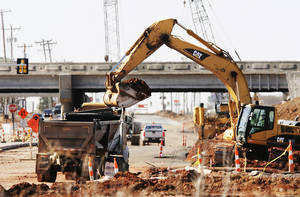 Photo - Construction on the Broadway Extension and Memorial Road interchange project is four weeks ahead of schedule. PHOTO BY JIM BECKEL, THE OKLAHOMAN